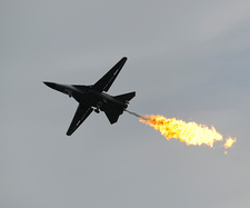 F-111 Aardvark aircraft performing a dump-and-burn