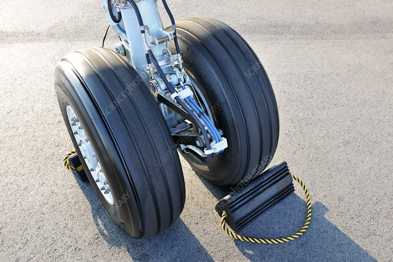 Turboprop passenger aircraft wheel and chock