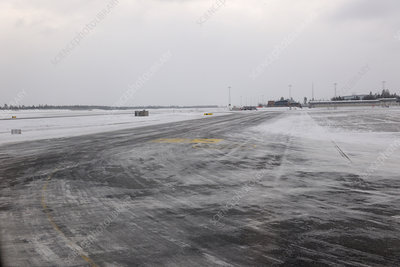 Snow on airport taxiway