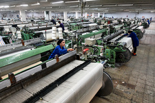 Textile mill machines and workers