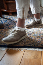 Older woman walking on rug in her home
