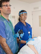 Surgeon and nurse during an endoscopy examination