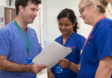 Doctor and nurses discussing patient notes