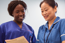 Nurses reading patient notes