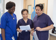 Nurses discussing patient notes