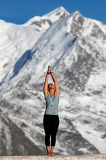 Woman Doing Yoga on Mountain