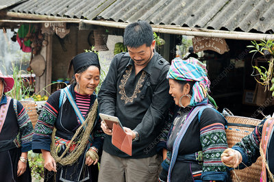 Hmong women with tourist, Vietnam