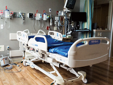 Empty bed in an intensive care unit