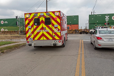 Ambulance waiting at level crossing, USA