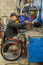 Disabled worker making wheelchair, Mexico