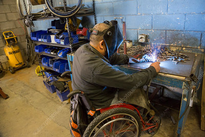 Disabled worker welding, Mexico