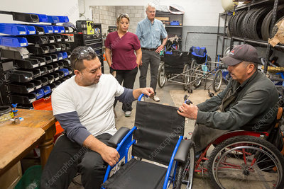 Disable workers assembling wheelchair, Mexico