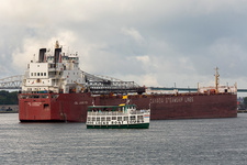 Tour boat and cargo ship, Soo Locks, Michigan, USA