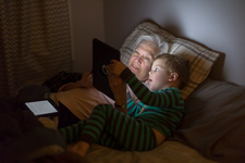 Grandmother and grandson using tablet computer