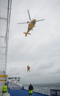 Coastguard pilot boarding ship in storm, Netherlands