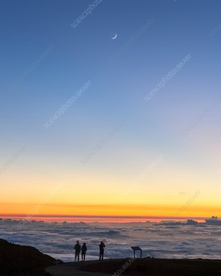 New moon over clouds
