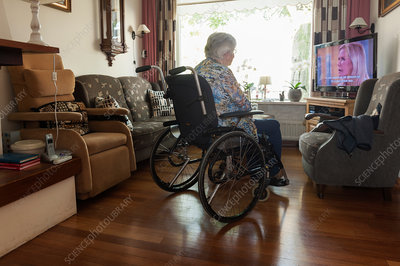 Elderly woman watching television