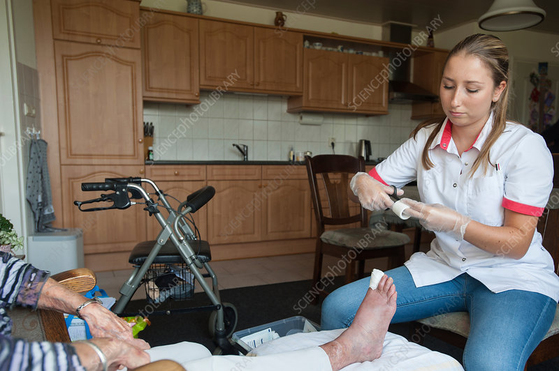Nurse dressing a foot wound
