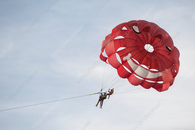 Tourists parasailing