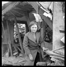 Girl by bombed building in London during World War II