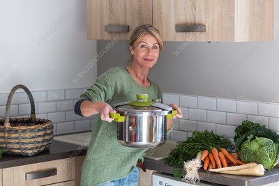 Woman using a pressure cooker