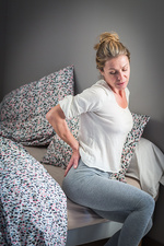 Woman suffering from lumbar pain