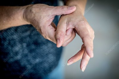 Senior woman suffering from pain in the hand