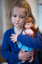 4 year old girl with her doll