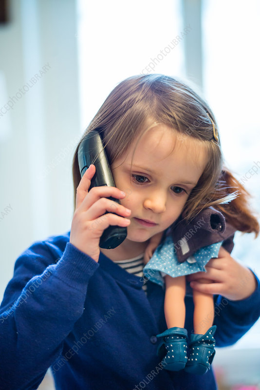 4 year-old girl using a phone