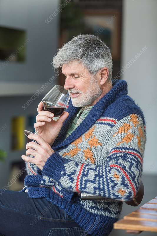 Man drinking a glass of red wine