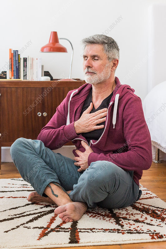 Man practicing respiratory exercises