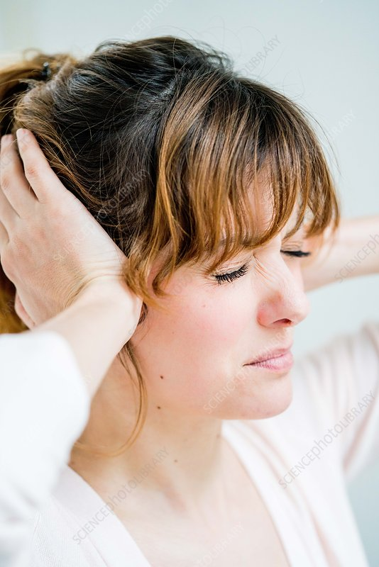 Woman holds her hands to her painful ears