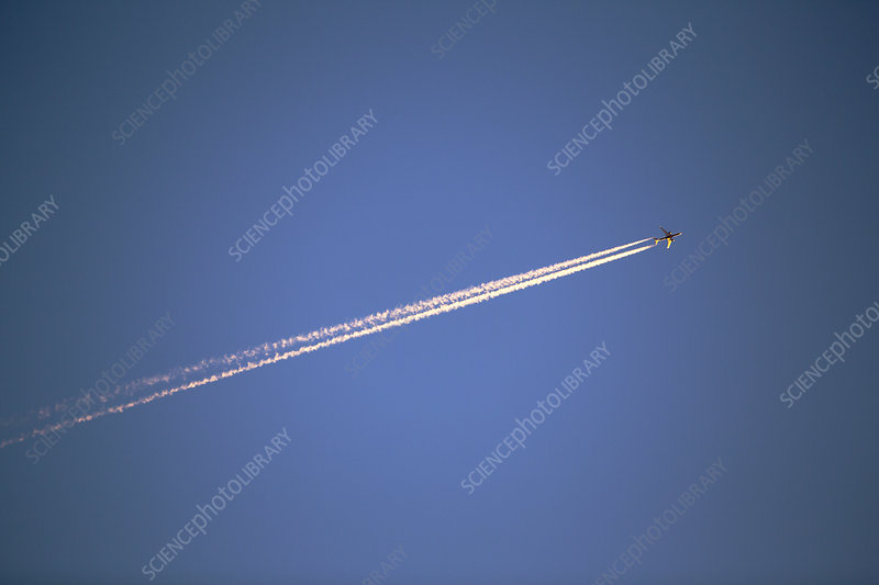A plane flying over Leicestershire at sunset