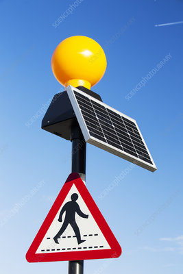 A pedestrian crossing light powered by a solar panel