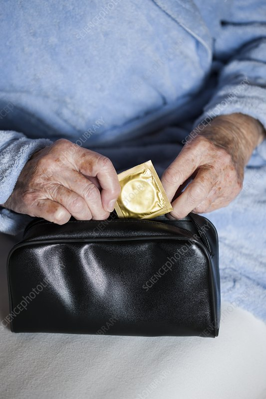 Close-up of elderly woman with condom