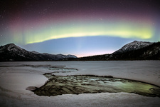 Aurora with dawn breaking over a river