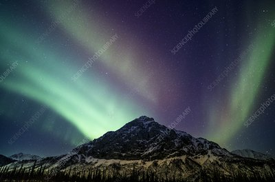 Aurora over a mountain range in Alaska