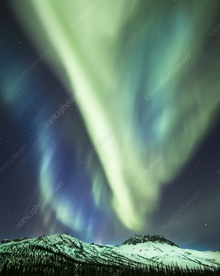 Aurora over mountains in Alaska