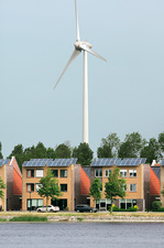 Wind turbine and houses with rooftop solar panels