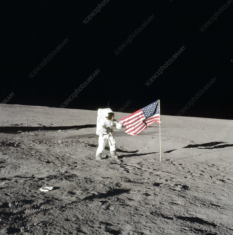 Apollo 12 commander unfurling US flag, 1969