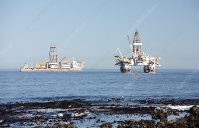 Oil rig and drillship at sea