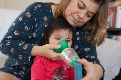17-month old baby girl using an inhaler