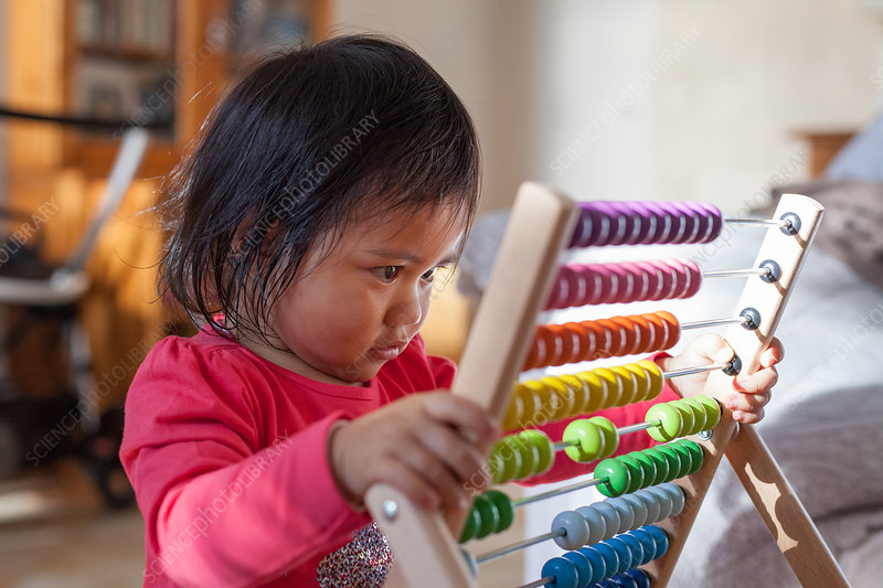Baby girl playing with abacus