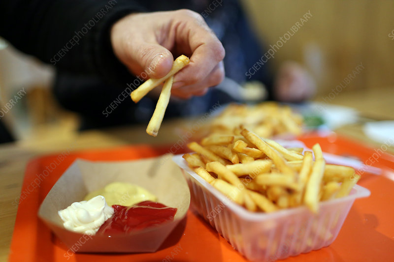 French fries with ketchup, mustard and mayonnaise