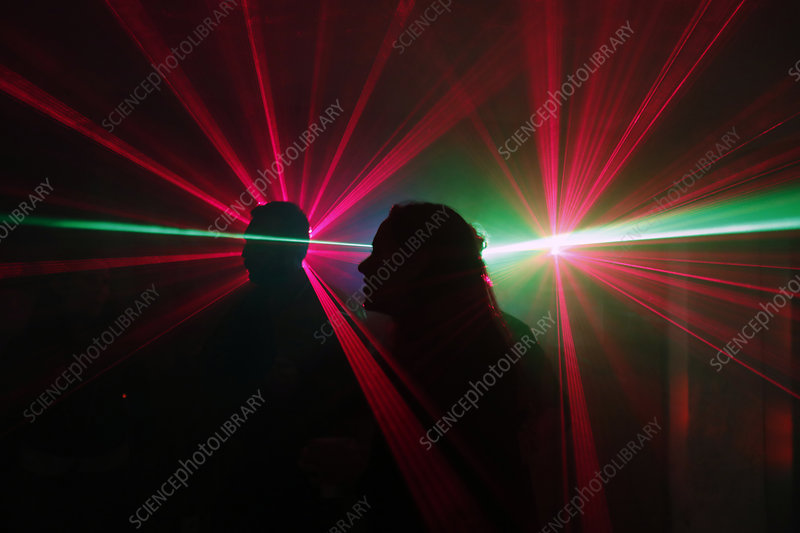 People dancing at a disco with laser lights