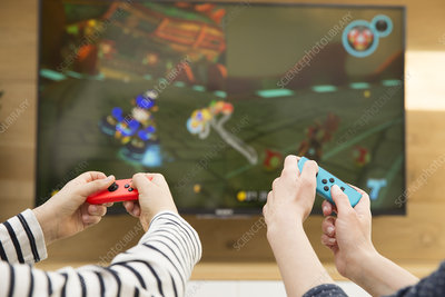 Mother and child playing video game