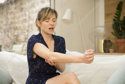 Woman suffering from elbow pain