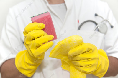Doctor with cleaning materials