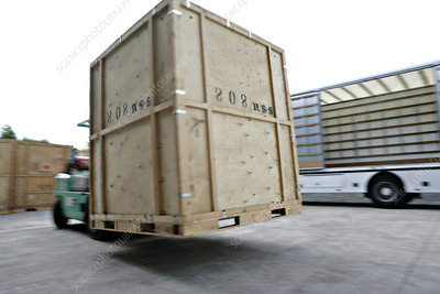 Loading crates into removals lorry