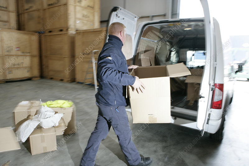 Loading boxes into removals van